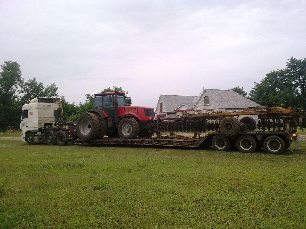 Перевозка трактора Case с навесным оборудованием