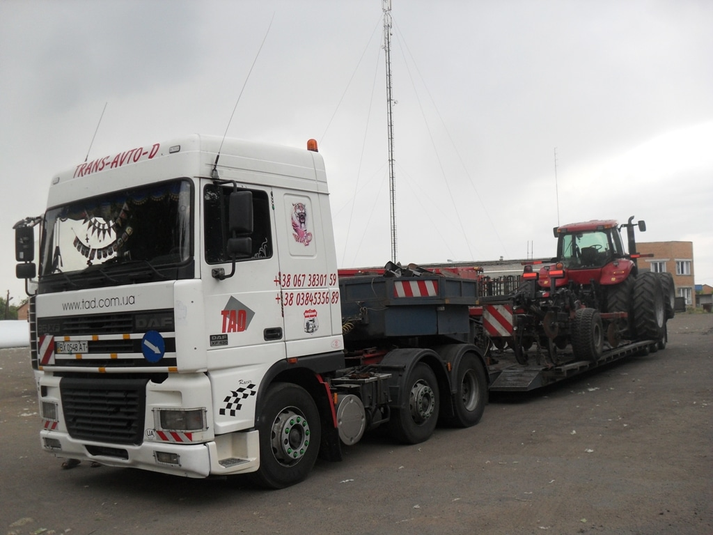 Перевозка дисковой бороны и трактора
