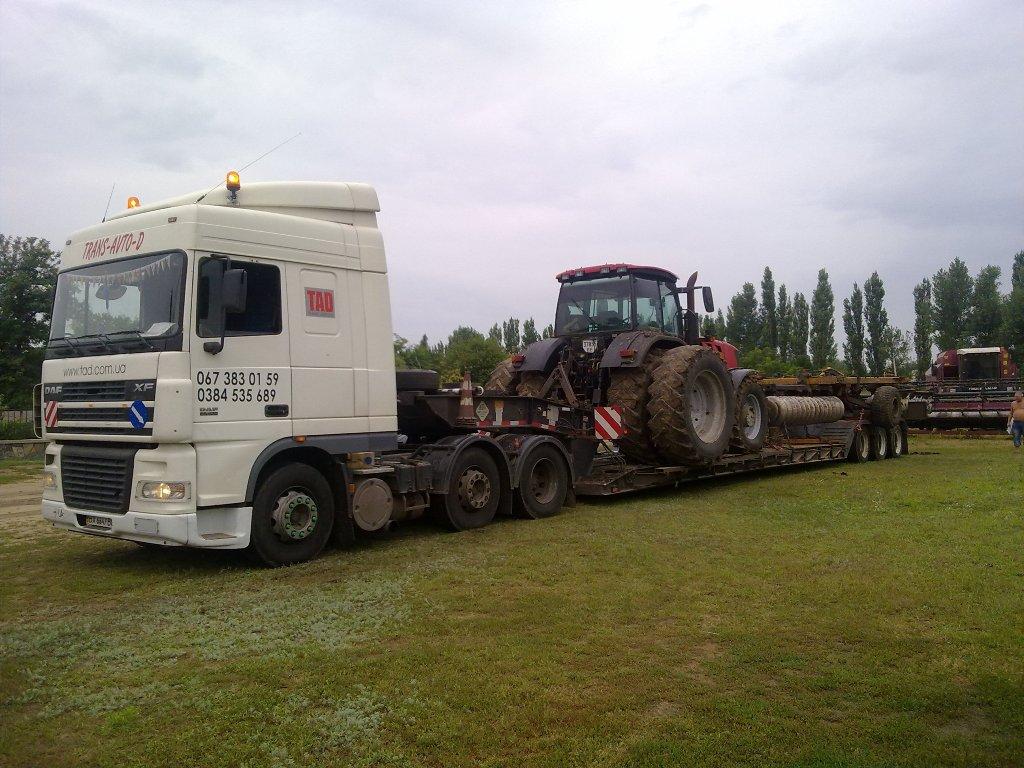 Перевозка трактора Case с дисковой бороной