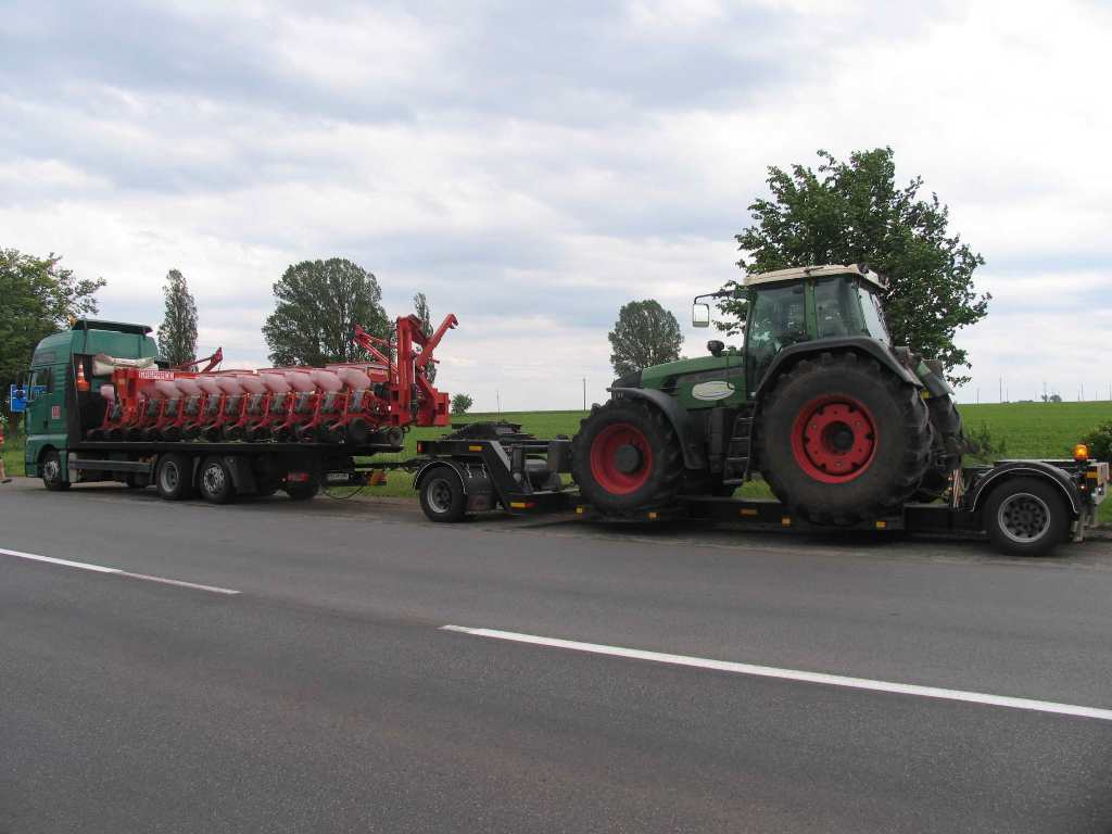 Transportation of tractor and seeder -3