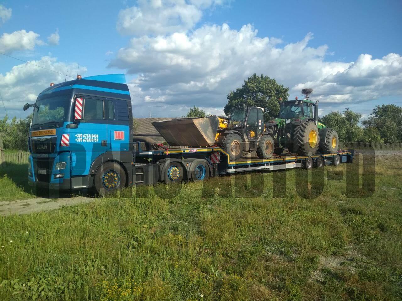 Под перевозку тралом трактор Джон Дир и маниту JCB