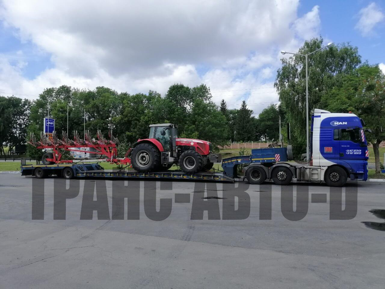 Transportation of a tractor with a plow in Ukraine