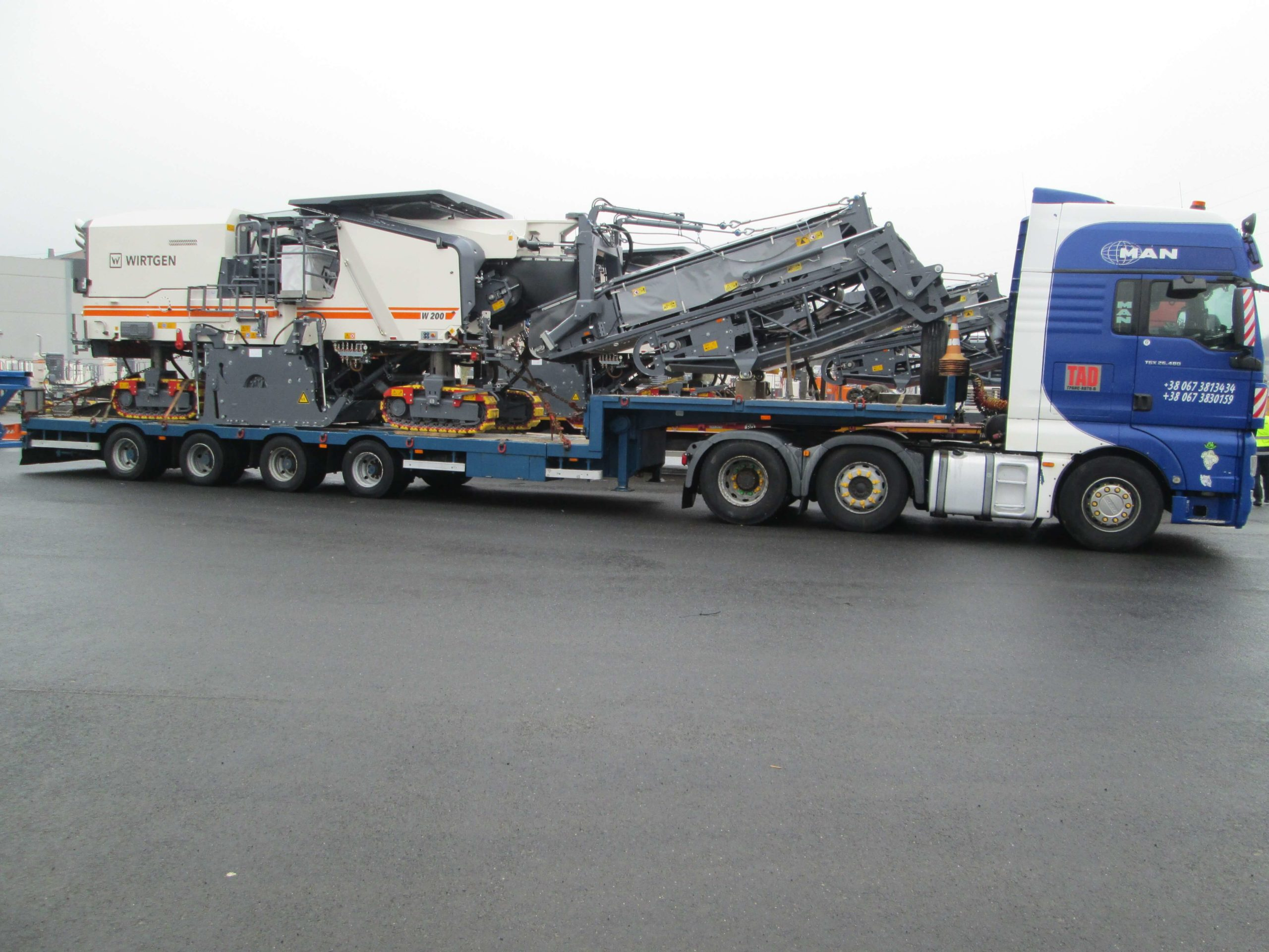 Transportation-of-road-milling-machine-Wirtgen-W200-on-route-Germany-Ukraine