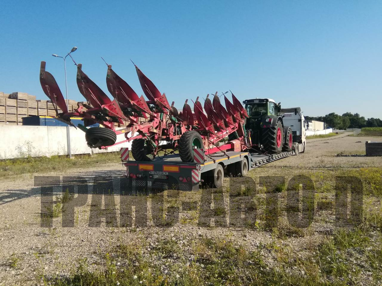 Transportation of a tractor with plows in Ukraine and abroad-2