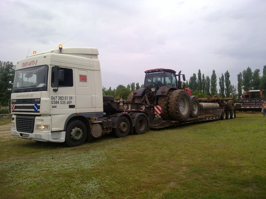 Case-tractor-transport-with-disc-harrow